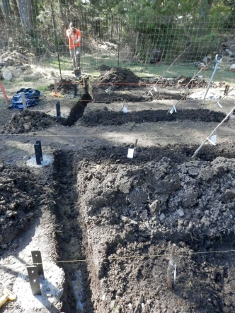 the drainage trench- filled with drainrock and a perforated pipe