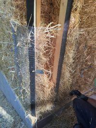the rest of the corner space stuffed with straw and held with metal lath